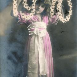 Beeldzijde nieuwjaarskaart, kind met jaartal, 1910