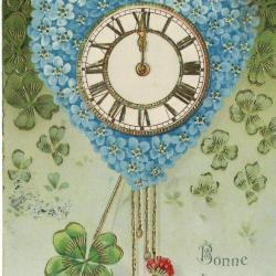 Beeldzijde nieuwjaarskaart, klok in hart van vergeet-mij-nietjes, 1903